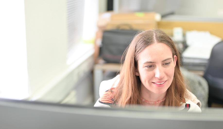 Katherine at desk - The superfast team